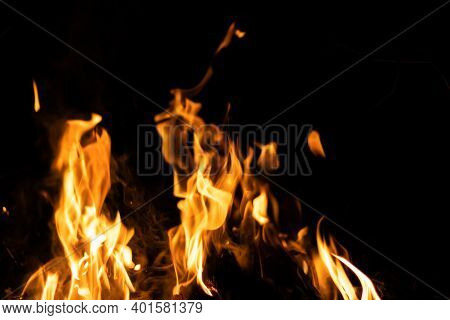 Fire Flames On A Black Background. Abstract Fiery Texture. Realistic Fire Flames Burn Movement Frame