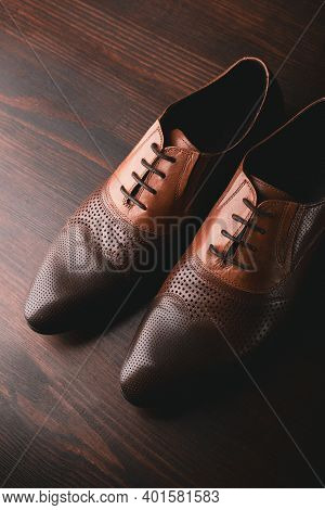 Stylish Men Shoes On Wooden Brown Background