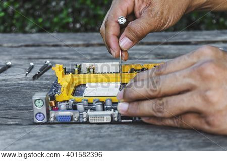 Closeup Hand Of Technician Open Socket Lock Cpu Or Central Processing Unit Chip Microprocessor Fixin
