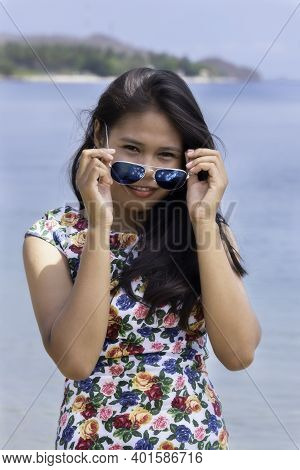 Portrait Of A Young Indonesian Girl With Sunglasses