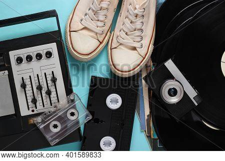 Flat Lay Retro Media Composition. Audio Recorder, Vinyl Records, Camera, Sneakers, Video And Audio C
