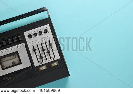 Retro Audio Tape Recorder. Retro Media On Blue Background. Top View. Copy Space