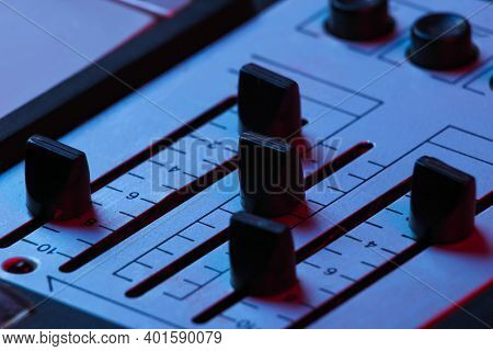 Dj Console Tuners In Pink-blue Neon Light Close-up