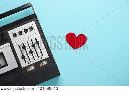Music Lover Concept. Retro Audio Tape Recorder With Heart On Blue Background. Retro 80s. Top View