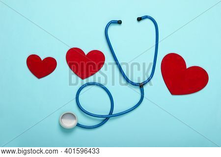 Stethoscope With Hearts On A Blue Pastel Background. Top View