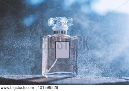 Perfume And Splashes On A Blue Background