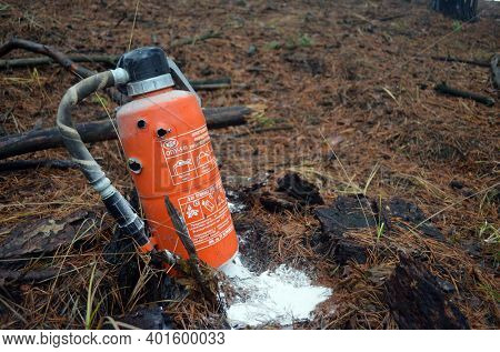 Fire extinguisher with bullet holes. Unformal shooting range near Kiev. January 1, 2021. Kiev Region, Ukraine