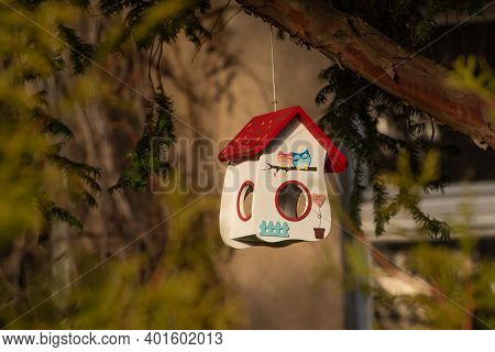 Little House Made For Birds Or Birdhouse In The Garden Of An Old And Stylish Building In Prague 6, C