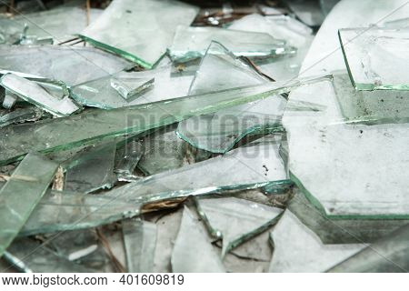 A Shattered Window On The Ground. Broken Glass Background. Shards.