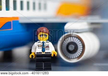 Tambov, Russian Federation - January 02, 2021 Lego Pilot Minifigure Standing In Front Of An Airplane