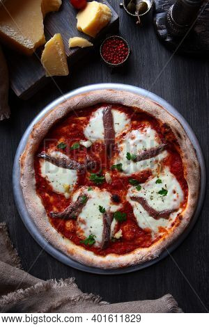 Pizza With Anchovies. Traditional Italian Pizza. Metal Plate For Serving Pizza. A Piece Of Parmesan