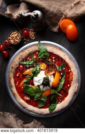 Pizza With Burrata Cheese And Pine Nuts. Italian Pizza. Metal Plate For Serving. Green Basil Leaves.