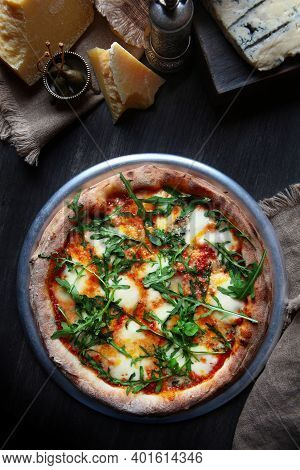 Pizza With Several Types Of Cheese, Arugula And Sauce. Traditional Italian Pizza. Metal Plate For Se