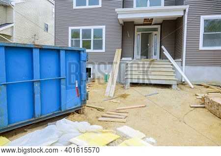 Dumpsters Construction Garbage In A Wood Frame Structure Of Incomplete House Under Construction On C