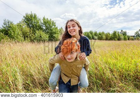 Summer Holidays Vacation Happy People Concept. Loving Couple Having Fun In Nature Outdoors. Happy Yo