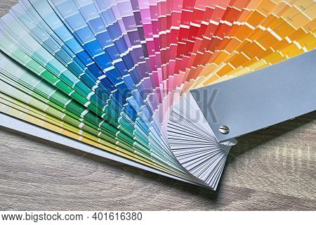 Color Wheel Palette For Choosing Paint Tone. Various Colors On Wooden Table Background With Copy Spa