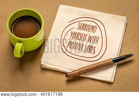 surround yourself with positive vibes - inspirational note on a napkin with a cup od coffee, positivity and personal development concept