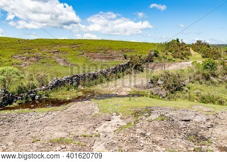 Farm Field With Road And Stream