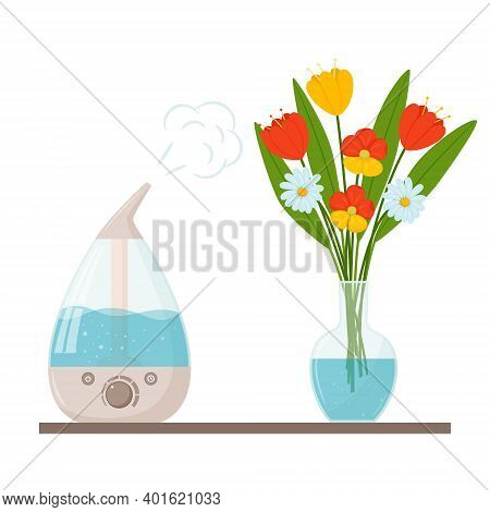 A Humidifier And A Bouquet Of Flowers In A Clear Glass Vase With Water. The Concept Of Using An Ultr