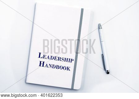 White Leadership Handbook Or Manual With White Pen On White Table Surface - Personnel Management Pol