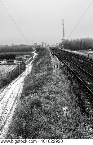 A Field Road Along The Railway Embankment. Railway Traction Near The Railway Station.