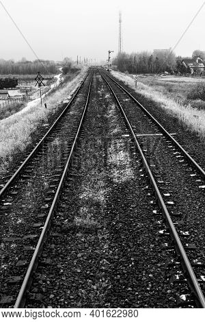 Two Railroad Tracks Leading Through The Fields. Railway Traction Near The Railway Station.