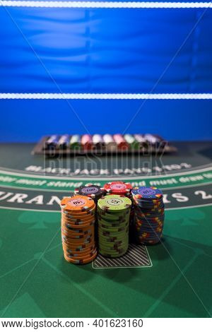 Casino chips on a gaming BlackJack table