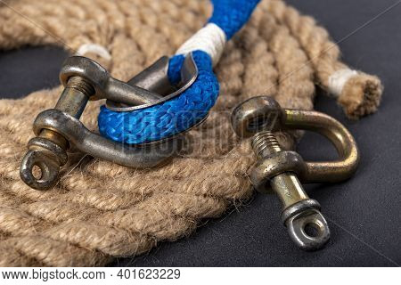 Shackle And Rope On The Table. Accessories For Sea Wolves On The Table.
