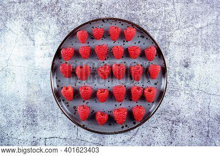 Fresh Ripe Raspberries On A Dark Background