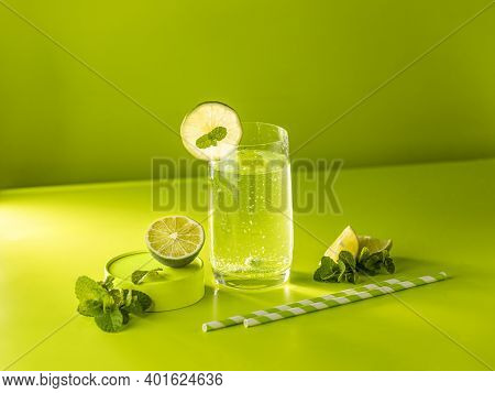 Creative Drink Background. Fresh Mojito Cocktail With Lime And Mint In Highball Glass With Water Dro