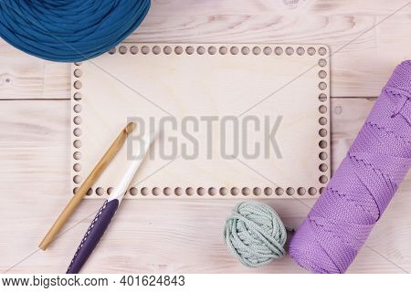 Crocheting Supplies, Hooks, Empty Blank Wooden Desk With Trendy Colors Yarn And Cord. Background For