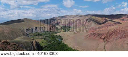 Panoramic view, colorful valley, red and brown hills. Altai Republic, Siberia, Russia.