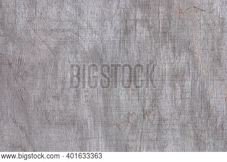 Texture Of Gray Faded Plywood With Cracks, Streaks And Stains From Damp And Bad Weather