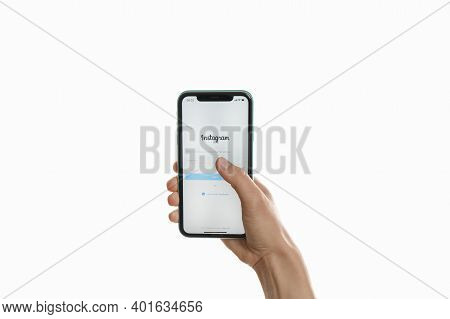 Mykolaiv, Ukraine - July 9, 2020: Woman Holding Iphone 11 With Instagram App On Screen Against White