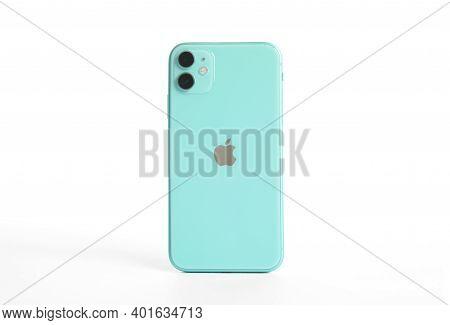 Mykolaiv, Ukraine - July 9, 2020: Green Iphone 11 Isolated On White