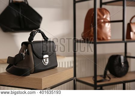 Elegant Black Bag On Table In Luxury Boutique