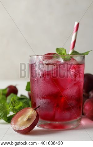 Delicious Grape Soda Water With Mint On White Table. Refreshing Drink