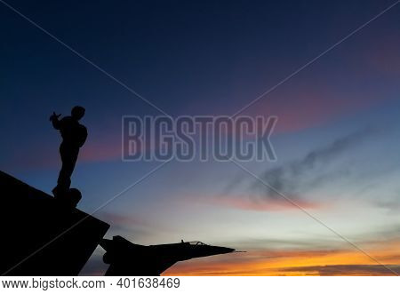 Rio Gallegos, Argentina- July 8, 2020: Sunset And Silhouettes Of Monuments,the Man Called Monument T