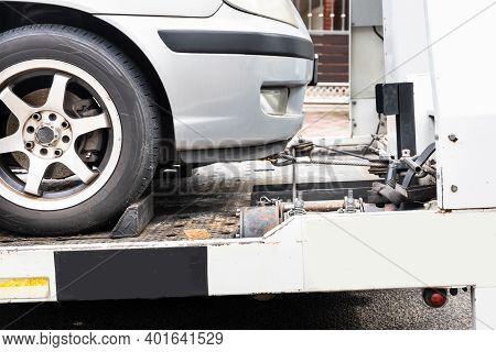 Broken Down Car Towed Onto Flatbed Tow Truck