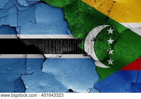 Flags Of Botswana And Comoros Painted On Cracked Wall