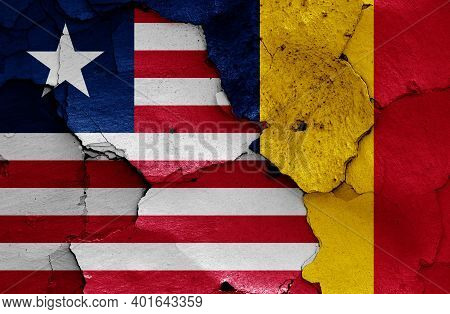 Flags Of Liberia And Chad Painted On Cracked Wall
