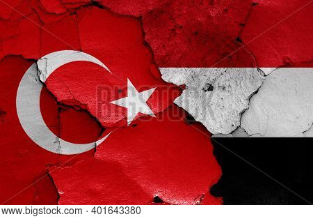 Flags Of Turkey And Yemen Painted On Cracked Wall