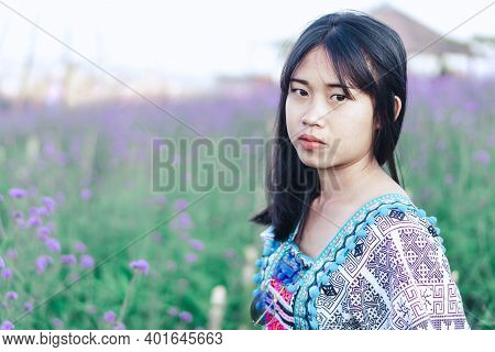 Portrait Of Asian Happy Woman Smiling With Flower Garden , Selective Focus