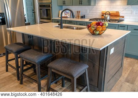 Kitchen Island With Healthy Fresh Fruits Faucet And Sink On The Countertop