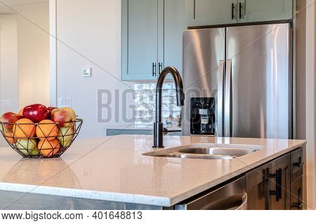 Kitchen Island With Black Curved Faucet And Stainless Steel Double Bowl Sink