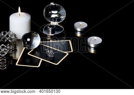 Christmas Magical Sessions With Tarot Cards, Candle, Ring And Mirror At Night In Dark Room. Mysterio