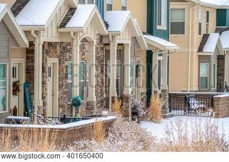 Apartments On A Winter Setting With Gabled Entrances Porches And Snowy Yards