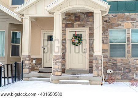 Entrance To Apartment Homes With Glass Paned Front Doors And Gable Roofs