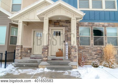 Apartment Home Entrance With Gable Roofs Over Whote Glass Paned Front Doors