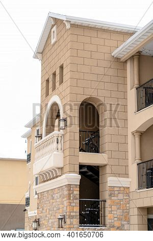 Resdiential Building With Gabled Front Design And Balconies On The Upper Floors